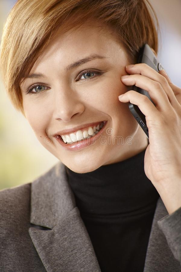 Attractive young woman talking on mobile phone royalty free stock photos