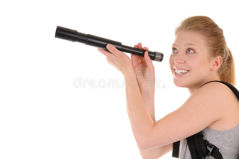Attractive young woman with telescope royalty free stock images