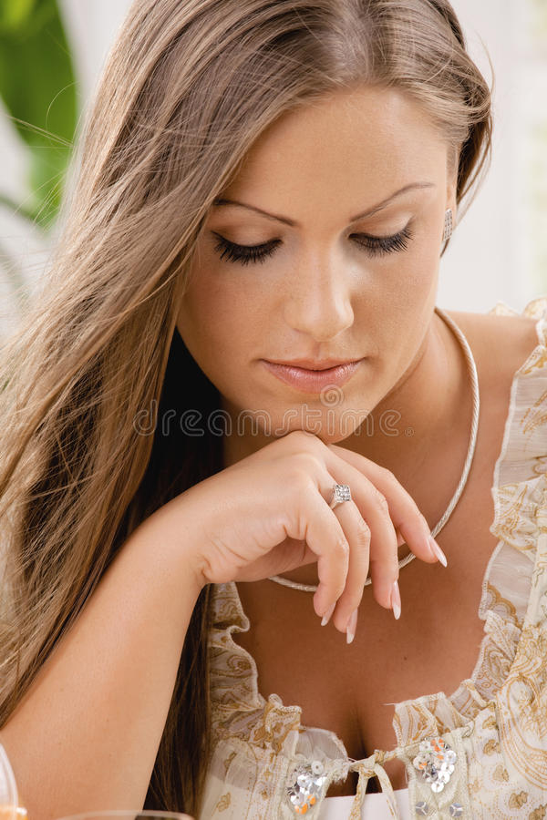 Attractive young woman thinking stock photography