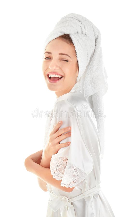 Attractive young woman in towel and silk robe royalty free stock photo