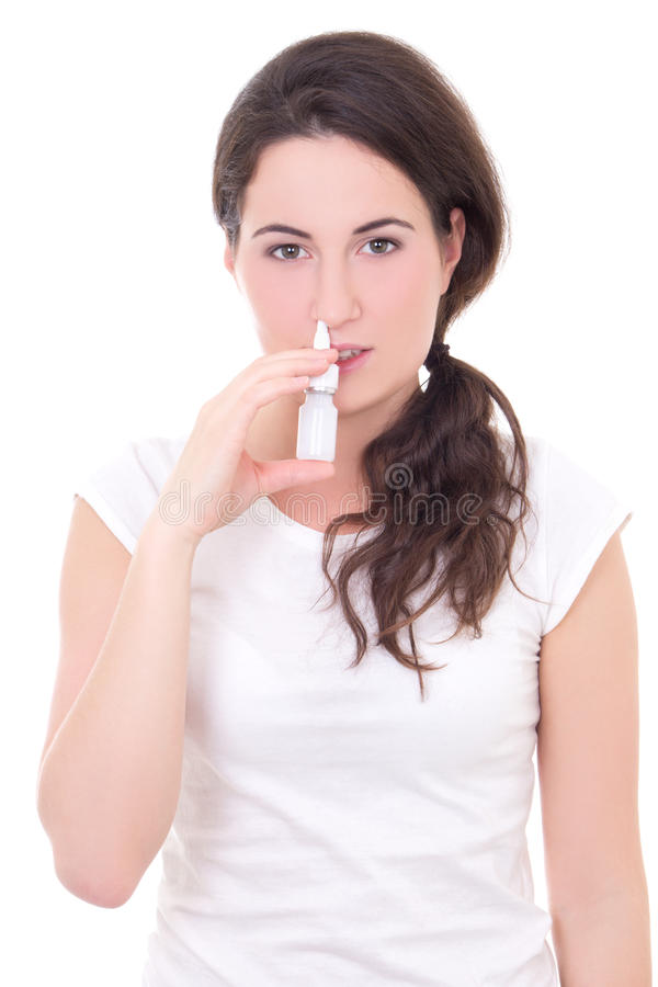 Man Using Nasal Spray In His Living Room Stock Photo - Image