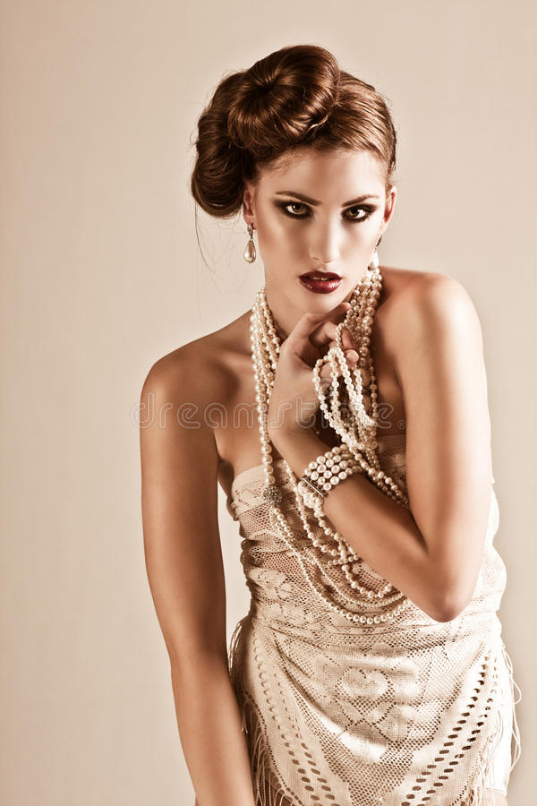 Download Attractive Young Woman Wearing Pearls And Nightwea Stock Image - Image: 13151443