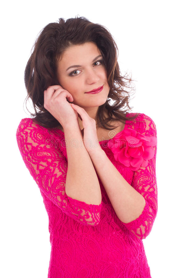 Attractive young woman wearing a pink dress stock photo