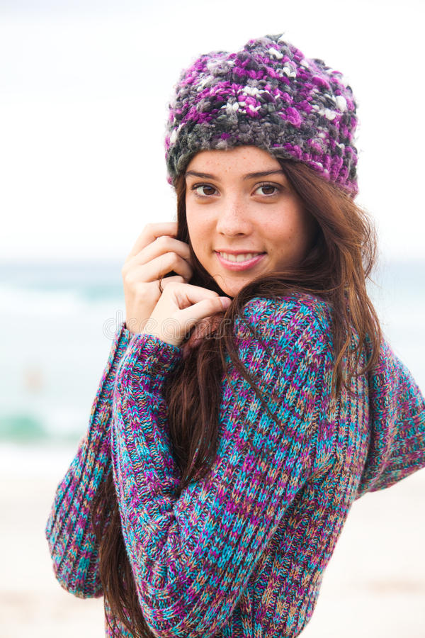 Attractive Young Woman Wearing a Sweater and Knit stock images