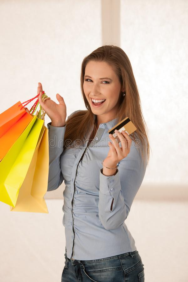 Attractive young woman wtih shopping bags after purchasing in ma stock photography