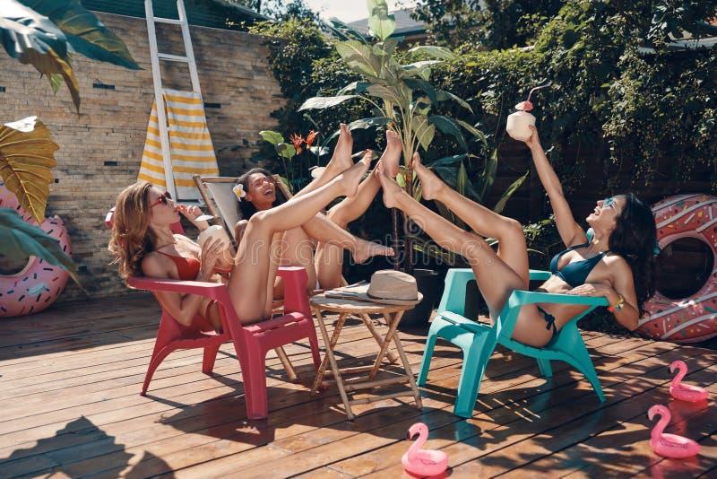 Attractive young women in bikini royalty free stock image