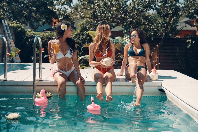 Attractive young women in bikini stock image