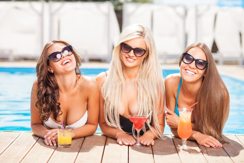 Attractive young women are enjoying drink in water stock images