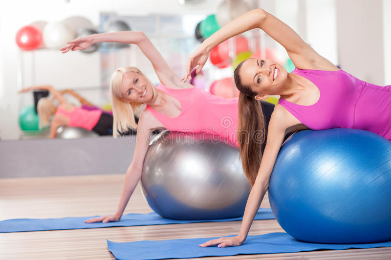 Attractive young women are exercising in gym stock photos