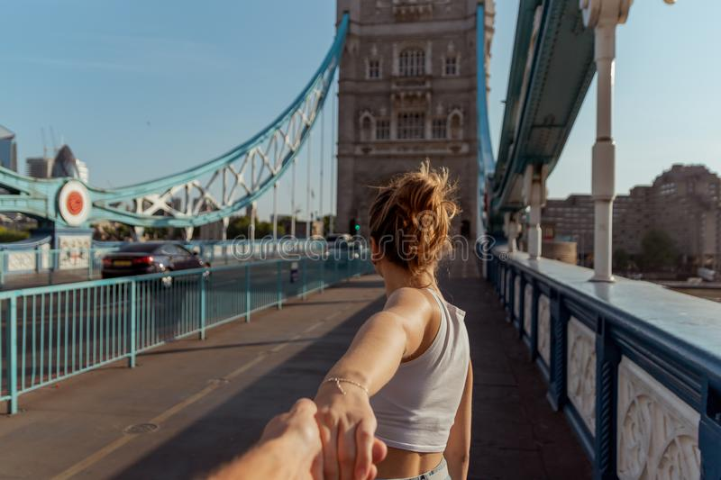 Couple follow me concept on the tower bridge in london royalty free stock images