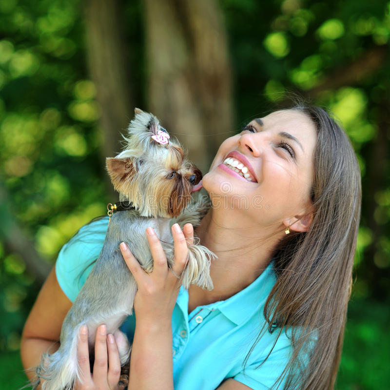Download Attractive Younggirl Playing With Her Puppy Outdoor Stock Photo - Image: 31993466
