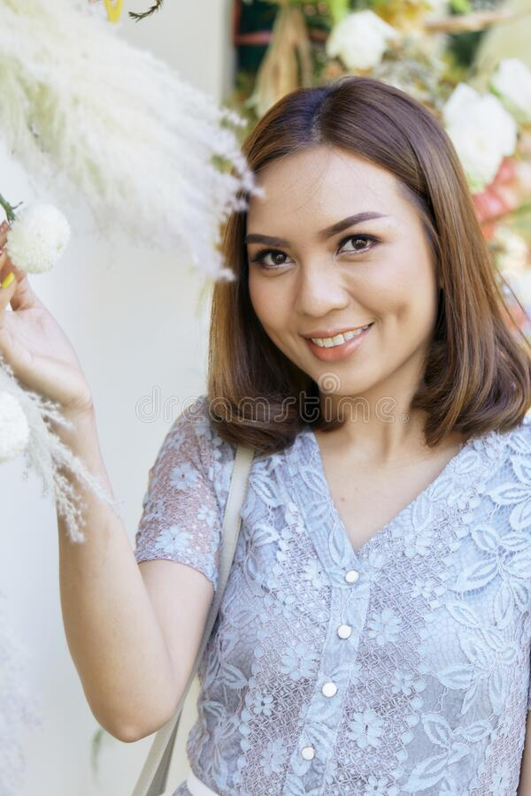 Attractive YoungThai woman smiling outdoors royalty free stock photos