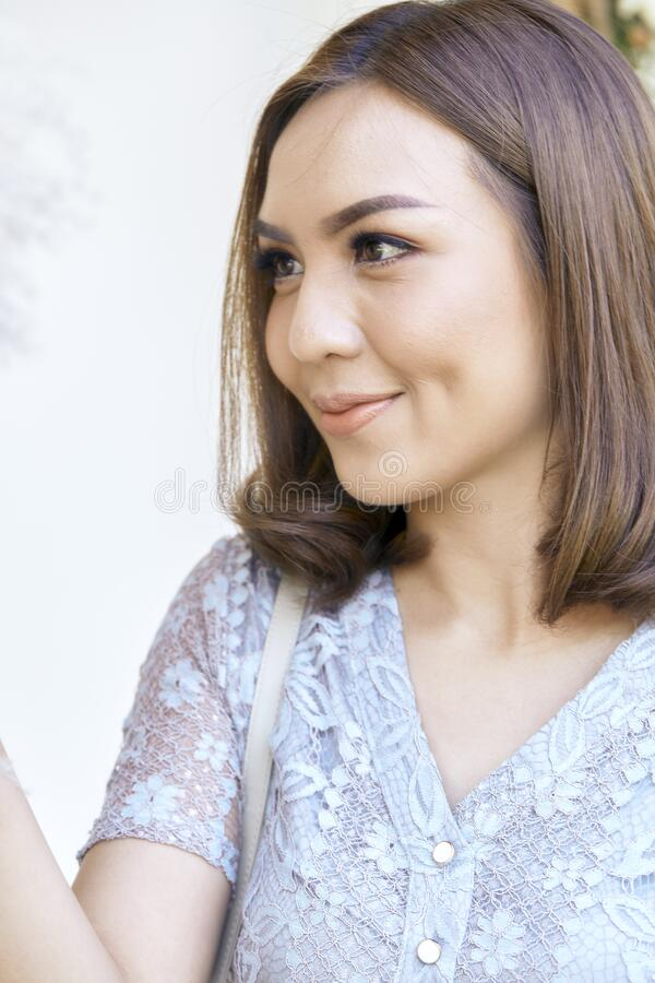 Attractive YoungThai woman smiling outdoors stock image
