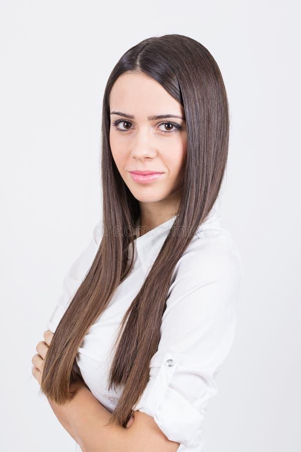 Attraktiv affärskvinna i den vita skjortan arkivbilder