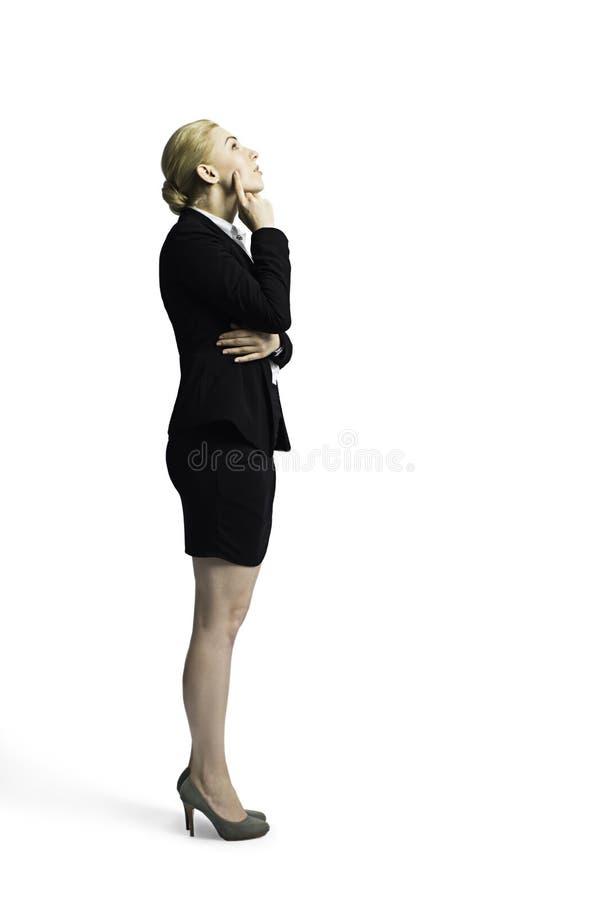 Attraktiv affärskvinna som tänker om ett problem fotografering för bildbyråer