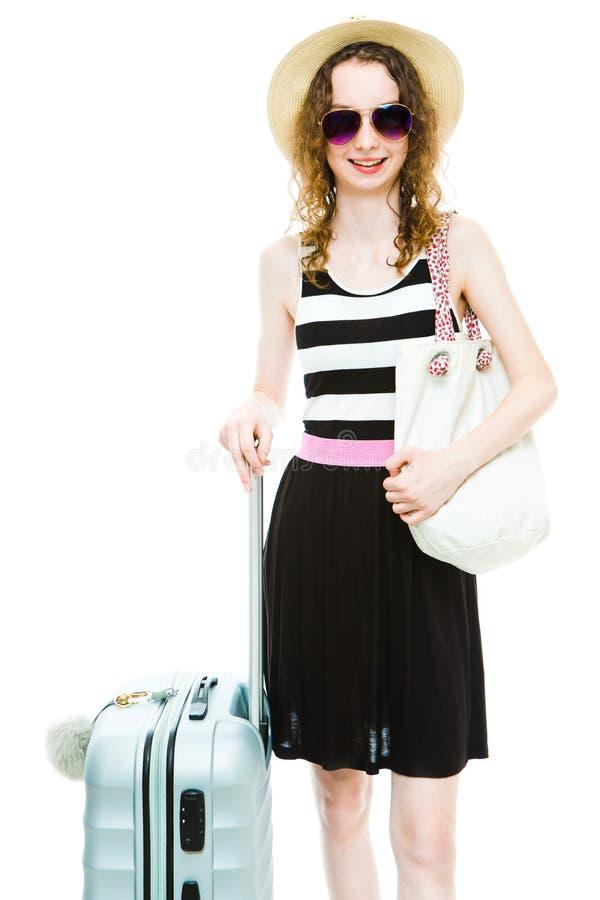 Attraktiv flicka med bagagefallet som ?r klart f?r ferie royaltyfria foton
