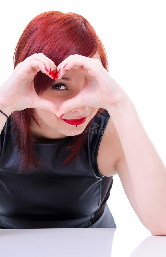 Attraktiv flicka med handhjärta arkivfoton