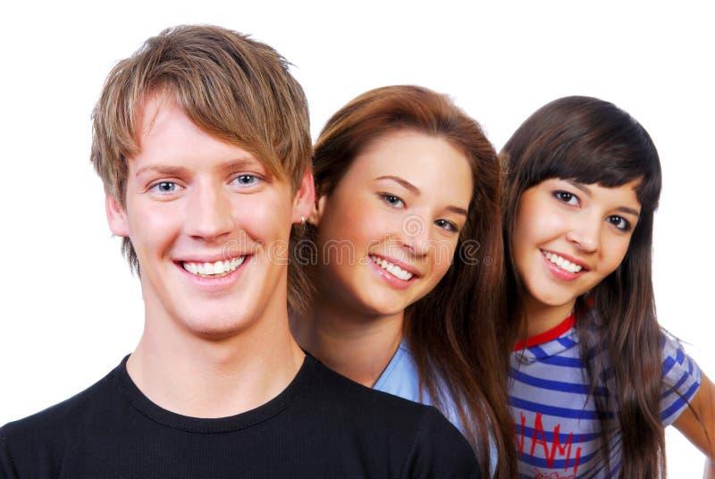 attraktiv gruppfolkstående arkivbild