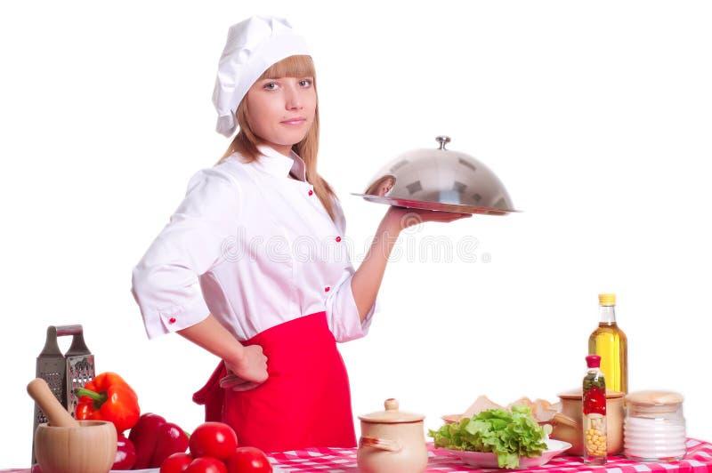 Attraktiv kockkvinna a över vit bakgrund arkivfoton
