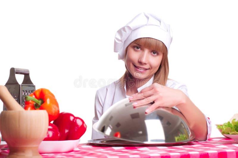 Attraktiv kockkvinna a över vitbakgrund royaltyfria foton