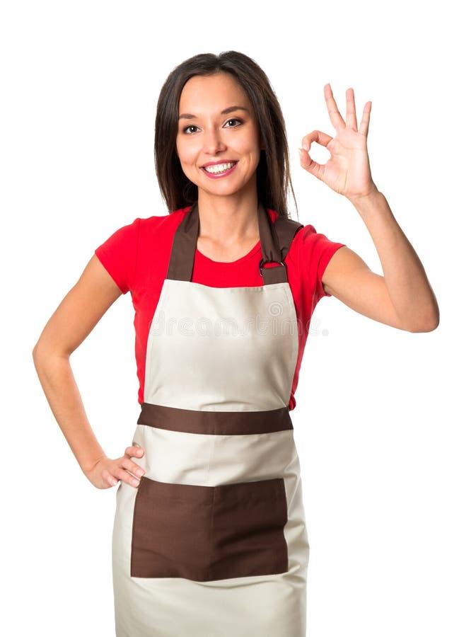 Attraktiv kockkvinna som ok visar över vit arkivfoton