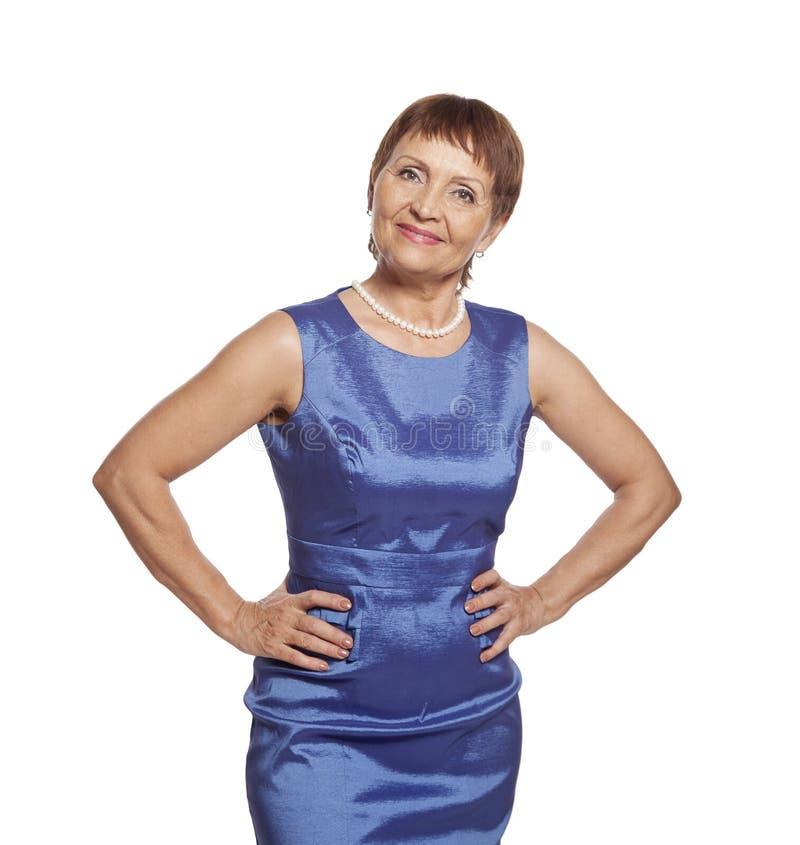 kvinna 50 år Attraktiv Kvinna 50 år I Blåttklänning Fotografering för  kvinna 50 år