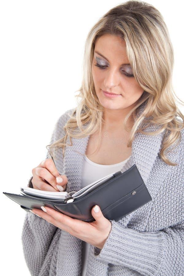 Attraktiv kvinna med kalendern royaltyfri bild