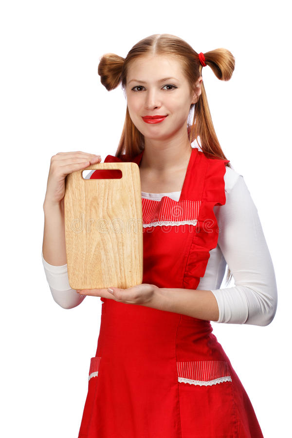 Attraktiv le hemmafru i rött förkläde med roliga hästsvansar a royaltyfria foton