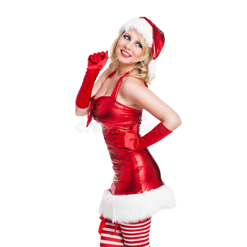 Attraktiv le kvinna i juldräkt royaltyfria foton