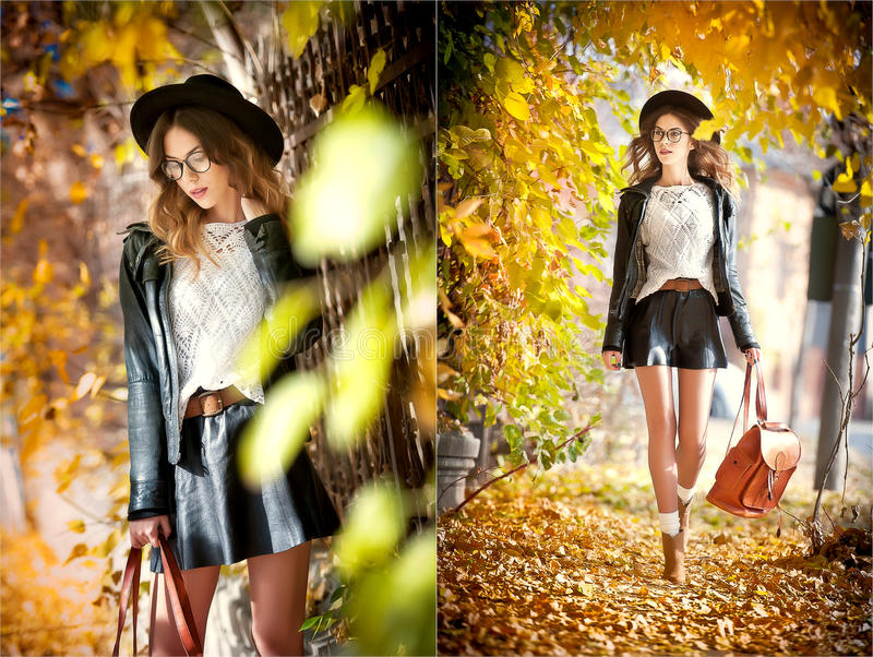 Attraktiv ung kvinna i ett höstligt skott utomhus Den härliga trendiga skolaflickan med läderryggsäcken som in poserar, parkerar arkivbild