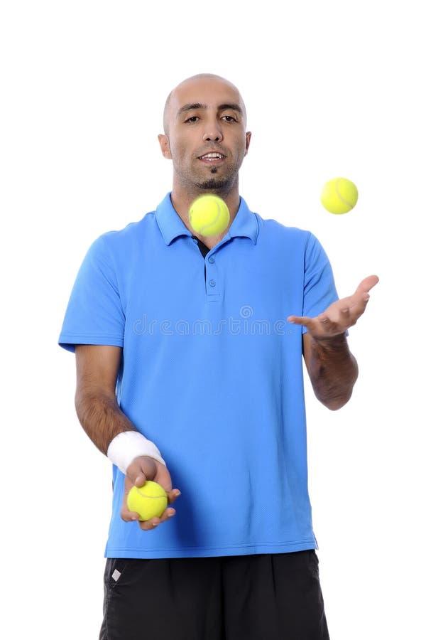 Attraktiv ung man som spelar tennisståenden royaltyfri bild