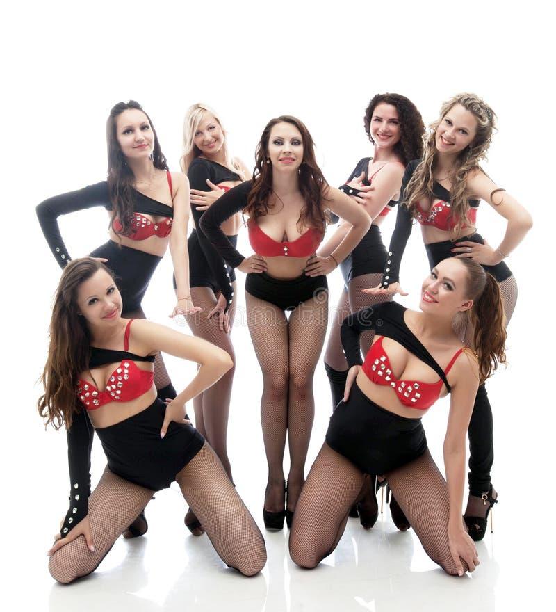 Attraktiva le flickor som poserar i erotiska dräkter royaltyfria foton