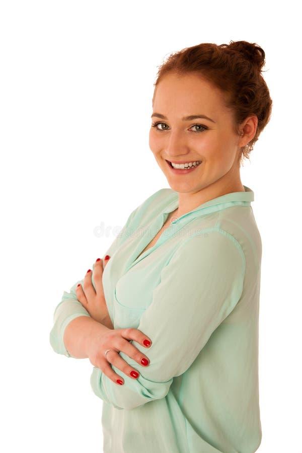 Attraktive überzeugte Geschäftsfrau mit dem braunen Haar, das ISO steht stockfoto
