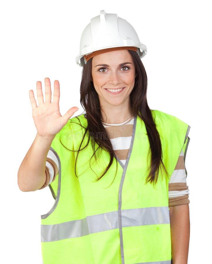 Attraktive Arbeitskraft mit Reflektorweste Saying Anschlag lizenzfreie stockfotos