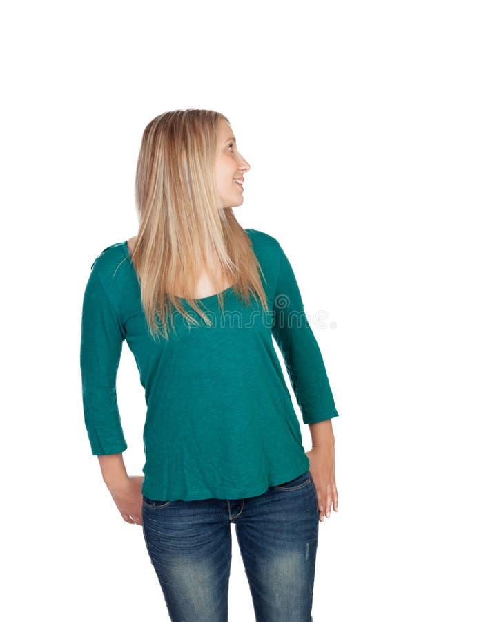 Attraktive Frau mit dem blonden Haar, das zurück schaut lizenzfreie stockfotografie