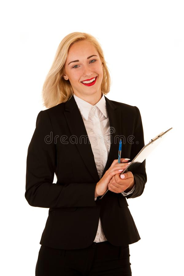 Attraktive Geschäftsfrau, die eine leere Fahne für zusätzliches hält lizenzfreie stockbilder