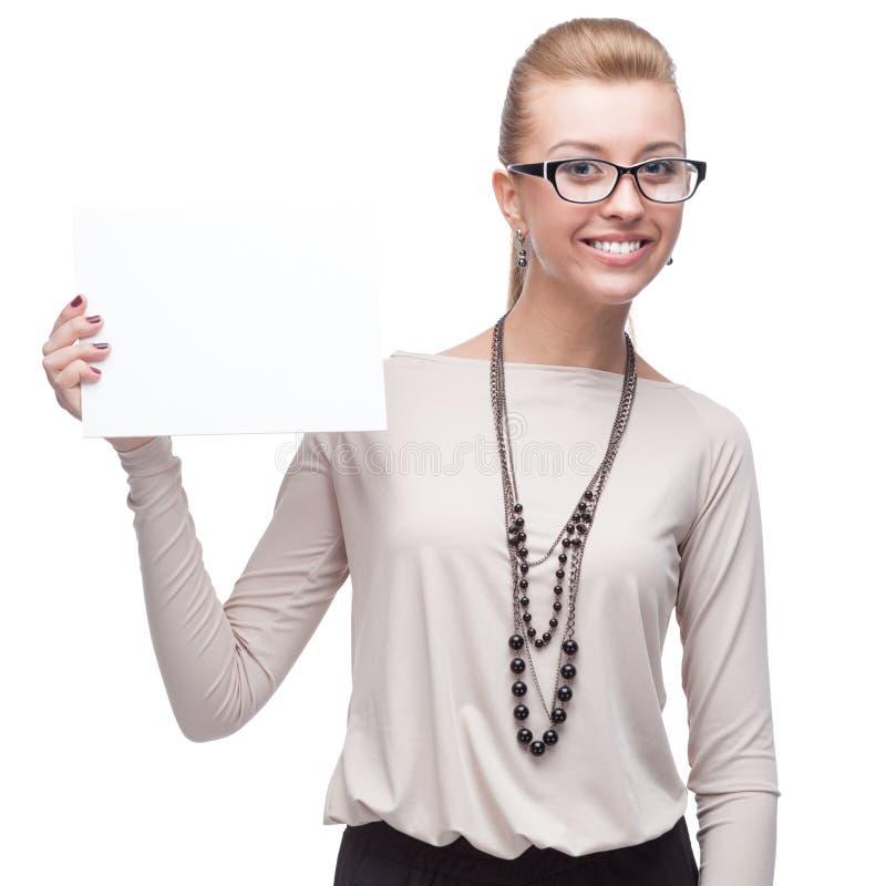 Attraktive Geschäftsfrau, die Zeichen hält lizenzfreie stockfotografie