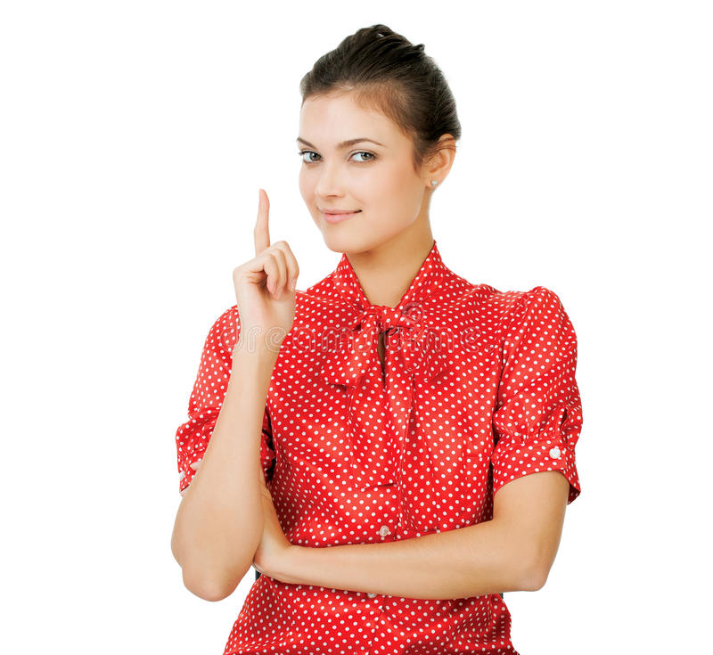 Attraktive junge Frau mit ihrem Finger oben stockfotos