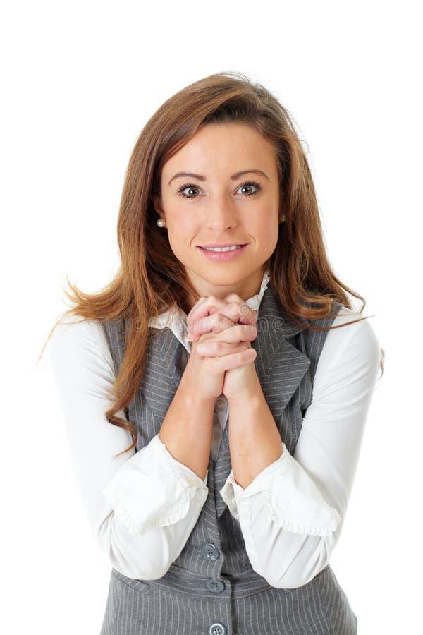 Attraktive junge Geschäftsfrau, dankbare Geste lizenzfreies stockbild