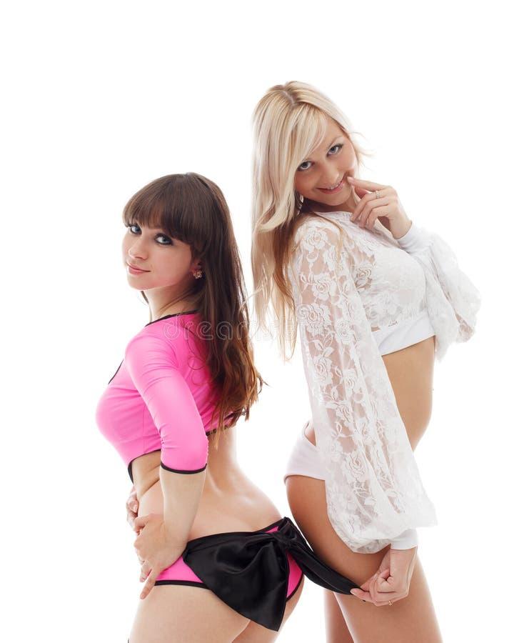 Attraktive junge Tänzer in den erotischen Kostümen stockfotos