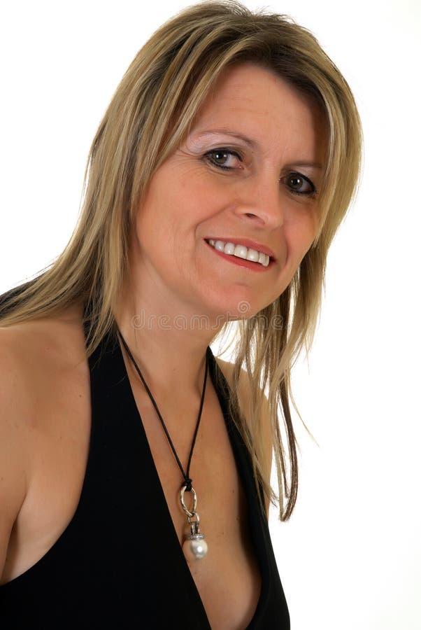 Attraktive mittlere gealterte Frau lizenzfreie stockfotos