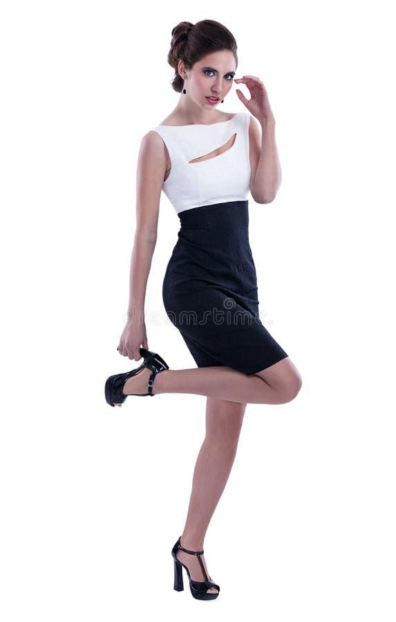Attraktive Modefrau im Kleid stockbilder