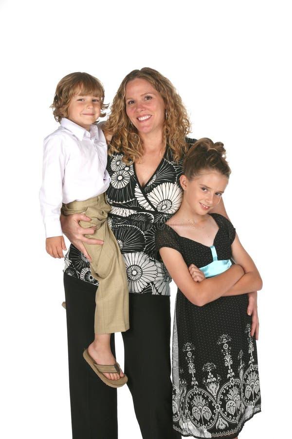 Attraktive Mutter und ihr Sohn und Tochter stockbilder