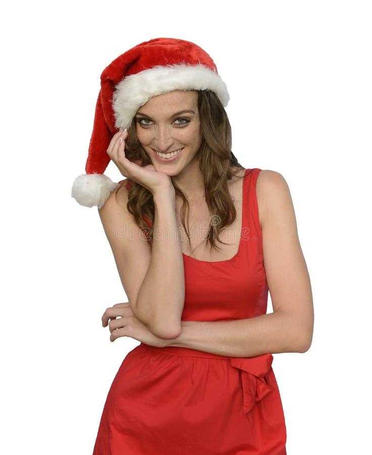 Attraktive Sankt-Frau, die frohe Weihnachten wünscht stockfotografie