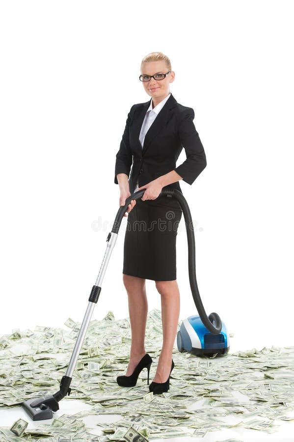 Attraktive weibliche Geschäftsfrau mit Staubsauger lizenzfreie stockfotografie