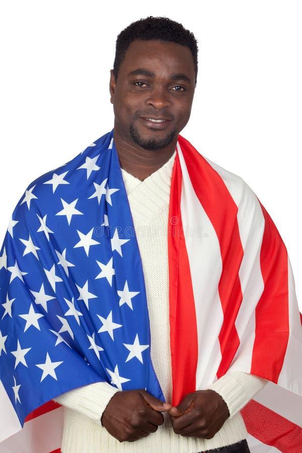 Attraktiver afrikanischer Mann mit einer amerikanischen Flagge lizenzfreie stockfotos