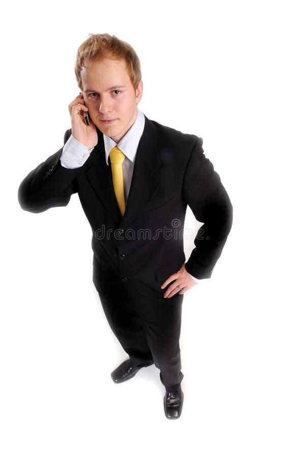 Attraktiver Geschäftsmann mit Telefon lizenzfreies stockbild