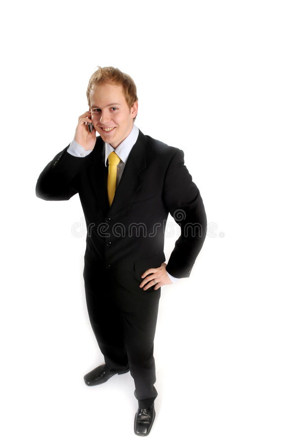 Attraktiver Geschäftsmann mit Telefon lizenzfreie stockfotos
