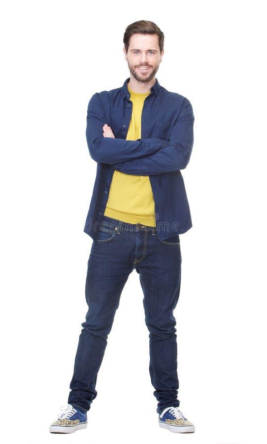 Attraktiver junger Mann, der auf lokalisiertem weißem Hintergrund lächelt stockfotos