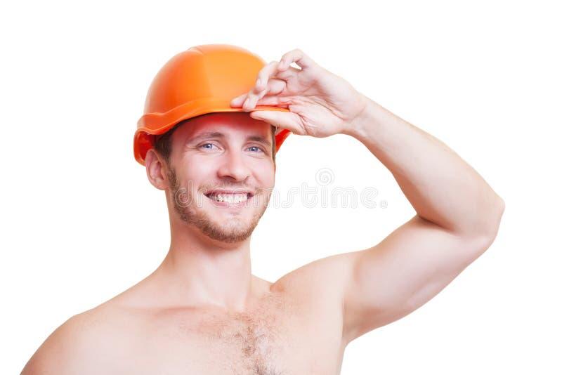 Attraktiver junger Mann in einem Sturzhelm, lokalisiert auf weißem Hintergrund lizenzfreies stockfoto